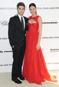 Odette Yustman Elton John Oscar Viewing party at the pacific design center red dress monique lhuillier peekaboo cutout gown red carpet 2 dave annable